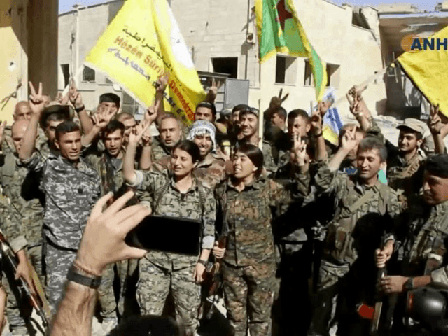 This frame grab from video released Tuesday, Oct. 17, 2017 and provided by Hawar News Agency, a Syrian Kurdish activist-run media group, shows fighters from the U.S.-backed Syrian Democratic Forces (SDF) celebrating their victory in Raqqa, Syria. U.S.-backed Syrian forces liberated the city of Raqqa from Islamic State militants on …