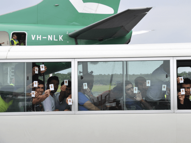 refugees-Eoin Blackwell:AAP Image, via AP