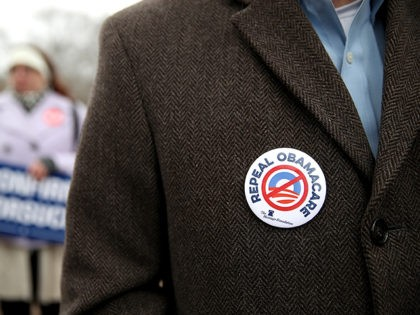 WASHINGTON, DC - MARCH 15: A protester wears a Repeal Obamacare button on his jacket during a Freedom Works rally against the proposed GOP health care plan at Upper Senate Park across from the U.S. Capitol on March 15, 2017 in Washington, DC. Hundreds of protesters with the conservative group …