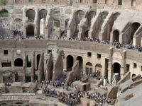 Tourists are seen visiting the ancient Colosseum as seen from the topmost floor on the occasion of a media tour presenting the re-opening after forty years of the fourth and fifth level of the Italy's most famous site, in Rome, Tuesday, Oct. 3, 2017. Italian Culture Minister Dario Francheschini was …