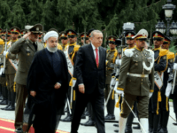 Iranian President Hassan Rouhani (L) welcomes Turkish counterpart Recep Tayyip Erdogan to Tehran on October 4, 2017 in a sign of warming ties between the two neighbours which both strongly oppose last week's Iraqi Kurdish vote for independence