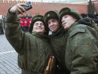 MOSCOW, RUSSIA - NOVEMBER 01: Russian soldiers take selfie before the rehearsal of the ceremonial march on Red Square, which will be held on November 7 dedicated to the 1941 parade in Moscow, Russia, on November 1, 2014. (Photo by Nikita Shvetsov/Anadolu Agency/Getty Images)