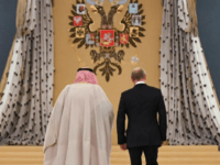 Russian President Vladimir Putin (R) and Saudi Arabia's King Salman bin Abdulaziz Al Saud walk during a welcoming ceremony ahead of their talks at the Kremlin in Moscow on October 5, 2017