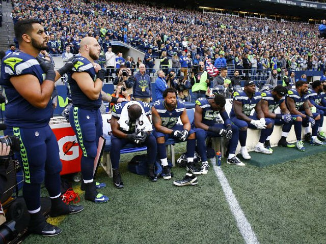 SEATTLE, WA - OCTOBER 1: Members of the Seahawks sit on the bench during the national anthem before the game against the Indianapolis Colts at CenturyLink Field on October 1, 2017 in Seattle, Washington. (Photo by Otto Greule Jr/Getty Images)