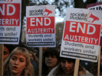 Demonstrators hold up placards at a protest march through central London on November 19, 2016 called by the National Union of Students and University College Union to demand free, quality further and higher education, accessible to all. / AFP / Daniel LEAL-OLIVAS (Photo credit should read DANIEL LEAL-OLIVAS/AFP/Getty Images)