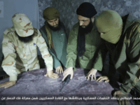 FILE -- This undated file photo, shows Abu Mohammed al-Golani, second right, then leader of Fatah al-Sham Front, in pictures posted by the group, discussing battlefield details with field commanders over a map, in Aleppo, Syria. Russia's military announced Wednesday, Oct. 4, 2017, that it carried out airstrikes in Syria …