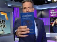 "CNN's ""The Lead"" host Jake Tapper holds up a pocket U.S. Constitution in response to President Trump's media criticism."