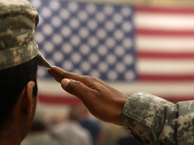 FORT CARSON, CO - JUNE 15: A soldier salutes the flag during a welcome home ceremony for troops arriving from Afghanistan on June 15, 2011 to Fort Carson, Colorado. More than 500 soldiers from the 1st Brigade Combat Team returned home following a year of heavy fighting and high casualties …