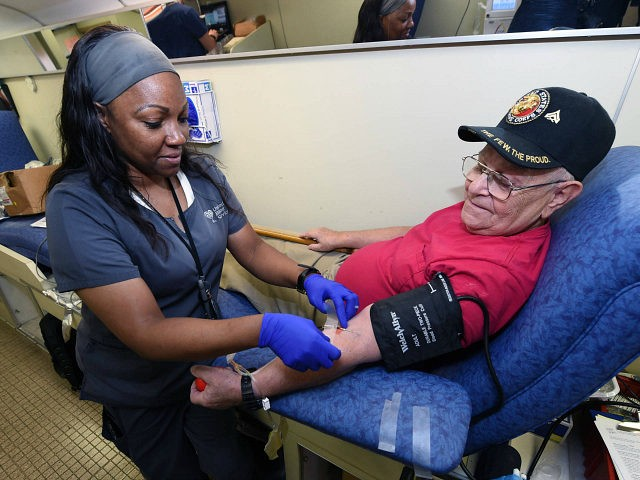 LAS VEGAS, NV - OCTOBER 02: United Blood Services phlebotomist Sha-Na Hill (L) takes blood from Richard Williams of Nevada at a special United Blood Services drive at a University Medical Center facility to help victims of a mass shooting on October 2, 2017 in Las Vegas, Nevada. A lone …