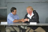 US President Donald Trump, seen here with Governor Ricardo Rossello (L), is visiting Puerto Rico for a first hand look at the damage left by Hurricane Maria