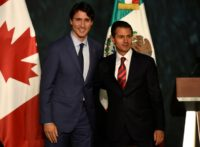 Canada's Prime Minister Justin Trudeau (L) and Mexican President Enrique Pena Nieto pose for a photo at the presidential palace in Mexico City, on October 12, 2017
