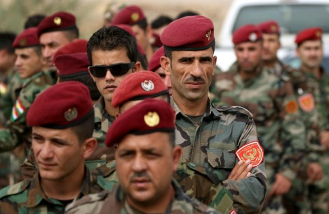 Kurdish peshmerga fighters, shown here voting in last month's independence referendum, are on alert for a possible attack by Iraqi troops and allied militia