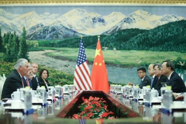 US Secretary of State Rex Tillerson (L) attends a meeting with Chinese State Councilor Yang Jiechi (R) at the Great Hall of the People in Beijing on September 30, 2017