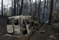 Two people died in a van trapped by flames near the town of Nigran, northwestern Spain, during wildfires