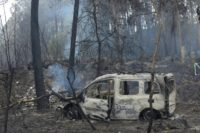 The wreckage of a burned van in which two people died trapped by flames