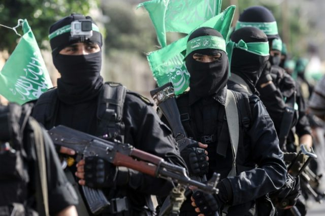 Fighters of the armed wing of Palestinian Islamist movement Hamas march in the southern Gaza city of Khan Yunis on July 20, 2017