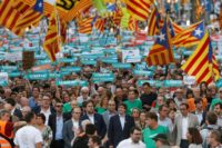 Catalan leaders including regional president Carles Puigdemont join a rally in Barcelona in support of separatists.