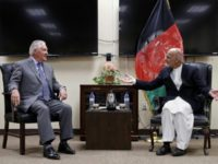 US Secretary of State Rex Tillerson (L) speaks with Afghan President Ashraf Ghani before their meeting at Bagram Air Field in Afghanistan on October 23, 2017