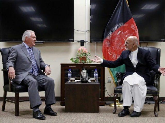 US Secretary of State Rex Tillerson (L) speaks with Afghan President Ashraf Ghani before their meeting at Bagram Air Field in Afghanistan on October 23, 2017