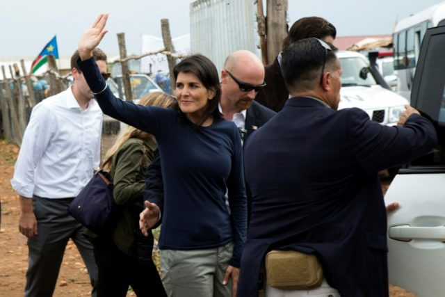 US Ambassador to the United Nations, Nikki Haley waves towards Internally Displaced People (IDP) while she is being evacuated by her protection force, following a demonstration at the UN Protection of Civilians (PoC) in Juba, South Sudan, on October 25, 2017. Nikki Haley arrived in Juba on October 25, seeking …
