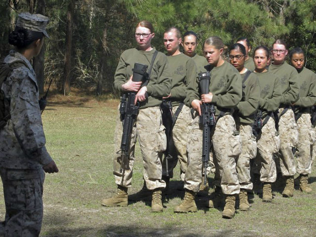 FILE - In this Feb. 21, 2013 file photo, female recruits stand at the Marine Corps Training Depot on Parris Island, S.C. The U.S. Marine Corps for the first time is eyeing a plan to let women attend what has been male-only combat training in Southern California, as officials work …