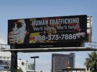 A billboard displays a phone number for the National Human Trafficking Hotline, Thursday, Sept. 21, 2017, in Las Vegas. The FBI in Las Vegas is teaming with a billboard company to raise the profile in the fight to stop human trafficking in a state where brothels are legal in rural …