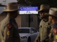Law enforcement officials work at the scene of a shooting at the First Baptist Church of Sutherland Springs, Monday, Nov. 6, 2017, in Sutherland Springs, Texas. A man opened fire inside the church in the small South Texas community on Sunday, killing and wounding many. (AP Photo/Eric Gay)
