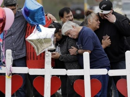 Family and friends gather around a makeshift memorial for the victims of the First Baptist Church shooting at Sutherland Springs Baptist Church, Friday, Nov. 10, 2017, in Sutherland Springs, Texas. A man opened fire inside the church in the small South Texas community on Sunday, killing more than two dozen. …