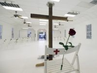 A memorial for the victims of the shooting at Sutherland Springs First Baptist Church includes 26 white chairs, each painted with a cross and and rose, is displayed in the church Sunday, Nov. 12, 2017, in Sutherland Springs, Texas. A man opened fire inside the church in the small South …