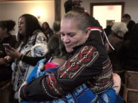 "HOLD FOR STORY BY PHILIP MARCELO -- In this Saturday, Nov. 18, 2017 photo Jessie ""Little Doe"" Baird, front right, vice chairwoman of the Mashpee Wampanoag tribe, hugs a member of the audience following the ""We Gather Together"" celebration at the Old Indian Meeting House, in Mashpee, Mass. For more …"