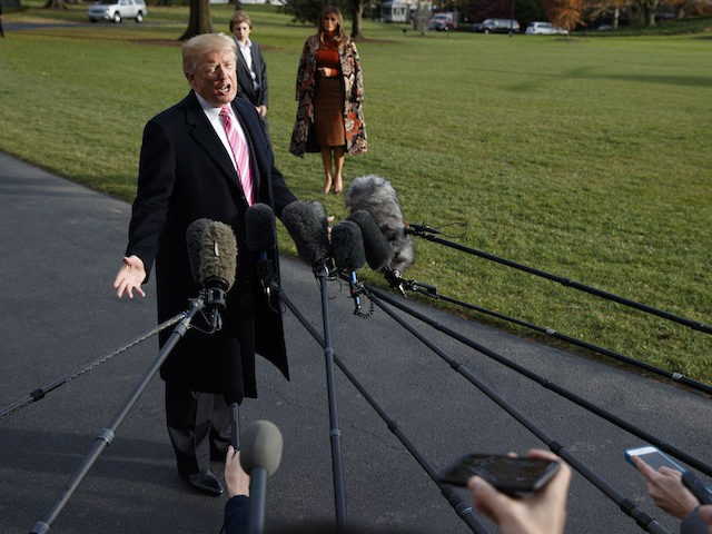 President Donald Trump speaks with reporters before departing the White House for Thanksgiving at his Mar-a-Lago resort, Tuesday, Nov. 21, 2017, in Washington. (AP Photo/Evan Vucci)