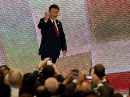 China's President Xi Jinping (C) arrives to speak on the final day of the APEC CEO Summit, part of the broader Asia-Pacific Economic Cooperation (APEC) leaders' summit, in the central Vietnamese city of Danang on November 10, 2017. World leaders and senior business figures are gathering in the Vietnamese city …