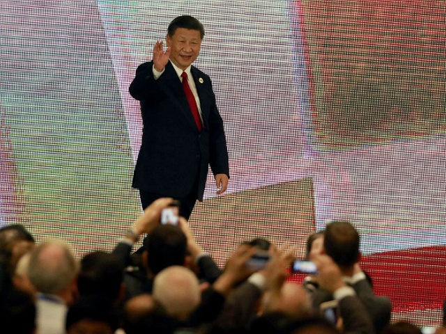 China's President Xi Jinping (C) arrives to speak on the final day of the APEC CEO Summit, part of the broader Asia-Pacific Economic Cooperation (APEC) leaders' summit, in the central Vietnamese city of Danang on November 10, 2017. World leaders and senior business figures are gathering in the Vietnamese city of Danang this week for the annual 21-member APEC summit. / AFP PHOTO / POOL / NYEIN CHAN NAING (Photo credit should read NYEIN CHAN NAING/AFP/Getty Images)