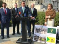 Rep. Duncan Hunter (R-CA) displays photos of Iranian-backed Shia militia using U.S. equipment.