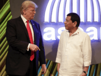 U.S. President Donald Trump, left, speaks with Philippine President Rodrigo Duterte before the opening ceremony of the 31st Association of Southeast Asian Nations (ASEAN) Summit in Manila, Philippines, Monday, Nov. 13, 2017. (Mark Cristino/Pool Photo via AP)