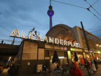 BERLIN, GERMANY - OCTOBER 16: People walk by the S-Bahn commuter train station at Alexanderplatz as the broadcast tower looms overhead near the site where Jonny, 20, was brutally beaten by an unidentified group in the early hours of October 14 on October 16, 2012 in Berlin, Germany. Jonny later …