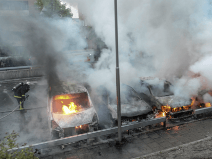 Firemen extinguish burning cars in the Stockholm suburb of Rinkeby after youths rioted in several different suburbs around Stockholm, Sweden for a fourth consecutive night on May 23, 2013. In the suburb of Husby, where the riots began on Sunday in response to the fatal police shooting of a 69-year-old …