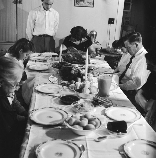 circa 1955: An American family, say grace before starting on the Thanksgiving turkey. (Photo by Evans/Three Lions/Getty Images)