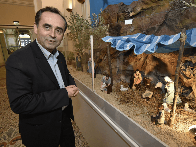 The mayor of Beziers, supported by the French far right Front national party (FN), Robert Menard, looks at a nativity scene displayed at the Beziers city hall on December 5, 2014. Menard wants to keep the Christmas creche installed in the town hall, despite of a letter of the Herault's …
