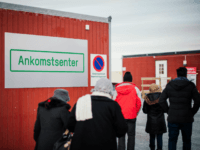 Refugees enter the arrival centre for refugees near the town on Kirkenes, northern Norway, close to the Russian - Norwegian border on November 12, 2015. An increasingly popular route for migrants across Russia and into Norway has Oslo angered and worried as winter approaches, while commentators suspect Moscow is deliberately …