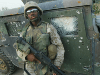 RAMADI, IRAQ: A US marine with 2/5 Marines stands in front of a Humvee hit by an Improvised Explosive Device, earlier in the week, in Ramadi, 100 kms west of Baghdad 04 November 2004. US war planes hammered the Iraqi rebel-held city of Fallujah on Thursday as locals braced for …