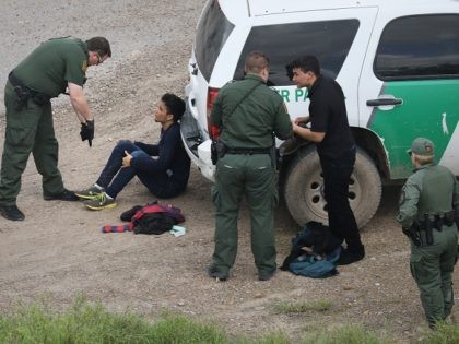 MCALLEN, TX - MARCH 15: U.S. Border Patrol agents detain two undocumented immigrants after capturing them near the U.S.-Mexico border on March 15, 2017 near McAllen, Texas. U.S. Customs and Border Protection announced that illegal crossings along the southwest border with Mexico dropped 40 percent during the month of February. …
