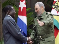 Zimbabwean President Robert Mugabe (L) is welcomed by Cuban President Fidel Castro at the State Council in Havana 12 September 2005. Mugabe landed in Cuba Saturday for an official three-day visit. AFP PHOTO/Adalberto ROQUE / AFP PHOTO / ADALBERTO ROQUE (Photo credit should read ADALBERTO ROQUE/AFP/Getty Images)