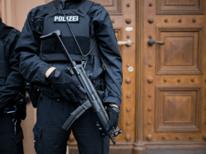 Police officers secure the courtroom of Celle, northern Germany, prior to the trial of the Iraqi jihadist Abu Walaa, accused of radicalising young men and running a jihadist network linked to the Berlin truck attacker, alongside four co-defendants accused of supporting IS, on September 26, 2017. Notorious hate preacher Abu …
