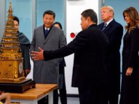 US President Donald Trump (2nd R) and First Lady Melania Trump (R) and China's President Xi Jinping (2nd L) and his wife Peng Liyuan (L partially obscured) look at an 18th century clock with lifting tower as they tour the Conservation Scientific Laboratory of the Forbidden City in Beijing on …
