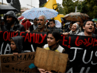 Refugees protest outside the German embassy in Athens under pouring rain, on November 8, 2017, to demand a faster family reunification process in Germany. Refugees are on hunger strike in Athens since November 1, to highlight the plight of 2,000 people waiting for at least six months to be allowed …