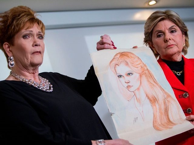 Attorney Gloria Allred (R) and Beverly Young Nelson hold up a drawing of Nelson when she was younger during a press conference on November 13, 2017, in New York, alledging that Roy Moore sexually assaulted Nelson when she was a minor in Alabama without her consent. The US Senate's top …