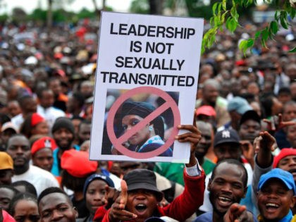 People hold an anti-Grace Mugabe placard during a demonstration demanding the resignation of Zimbabwe's president on November 18, 2017 in Harare. Zimbabwe was set for more political turmoil November 18 with protests planned as veterans of the independence war, activists and ruling party leaders called publicly for Zimbabwe's President to …