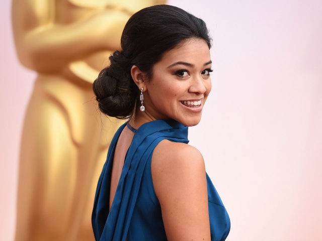 Gina Rodriguez arrives at the Oscars on Sunday, Feb. 22, 2015, at the Dolby Theatre in Los Angeles. (Photo by Jordan Strauss/Invision/AP)
