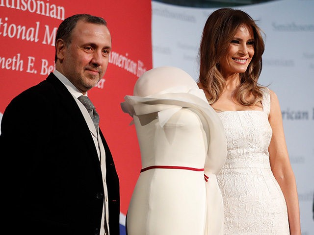First lady Melania Trump, right, donates her inaugural gown, designed by Herve Pierre, left, to the First Ladies' Collection at the Smithsonian's National Museum of American History, during a ceremony in Washington, Friday, Oct. 20, 2017. (AP Photo/Pablo Martinez Monsivais)